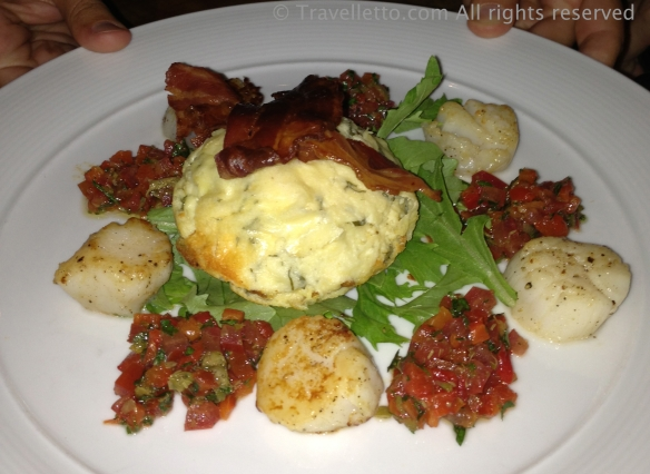 Twice baked goat's cheese soufflé with scallops and tomato