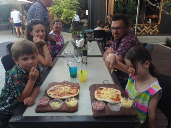 Kids making their own pizza
