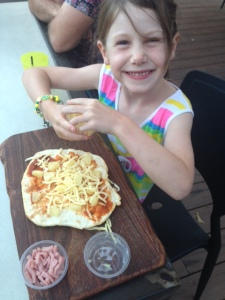 Niece Indi making her own pizza