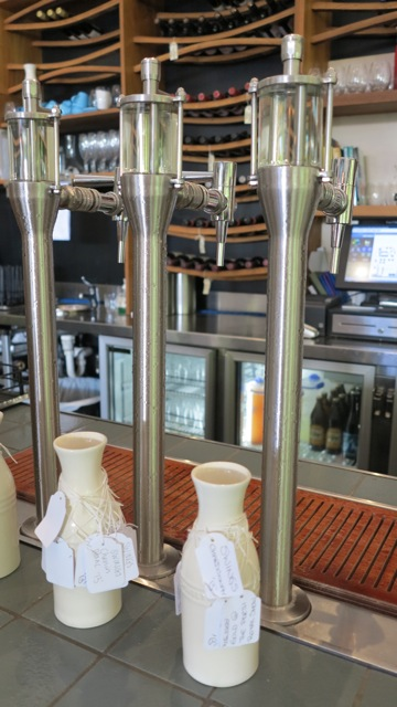 Tap white wines with the see through fronts and carafes